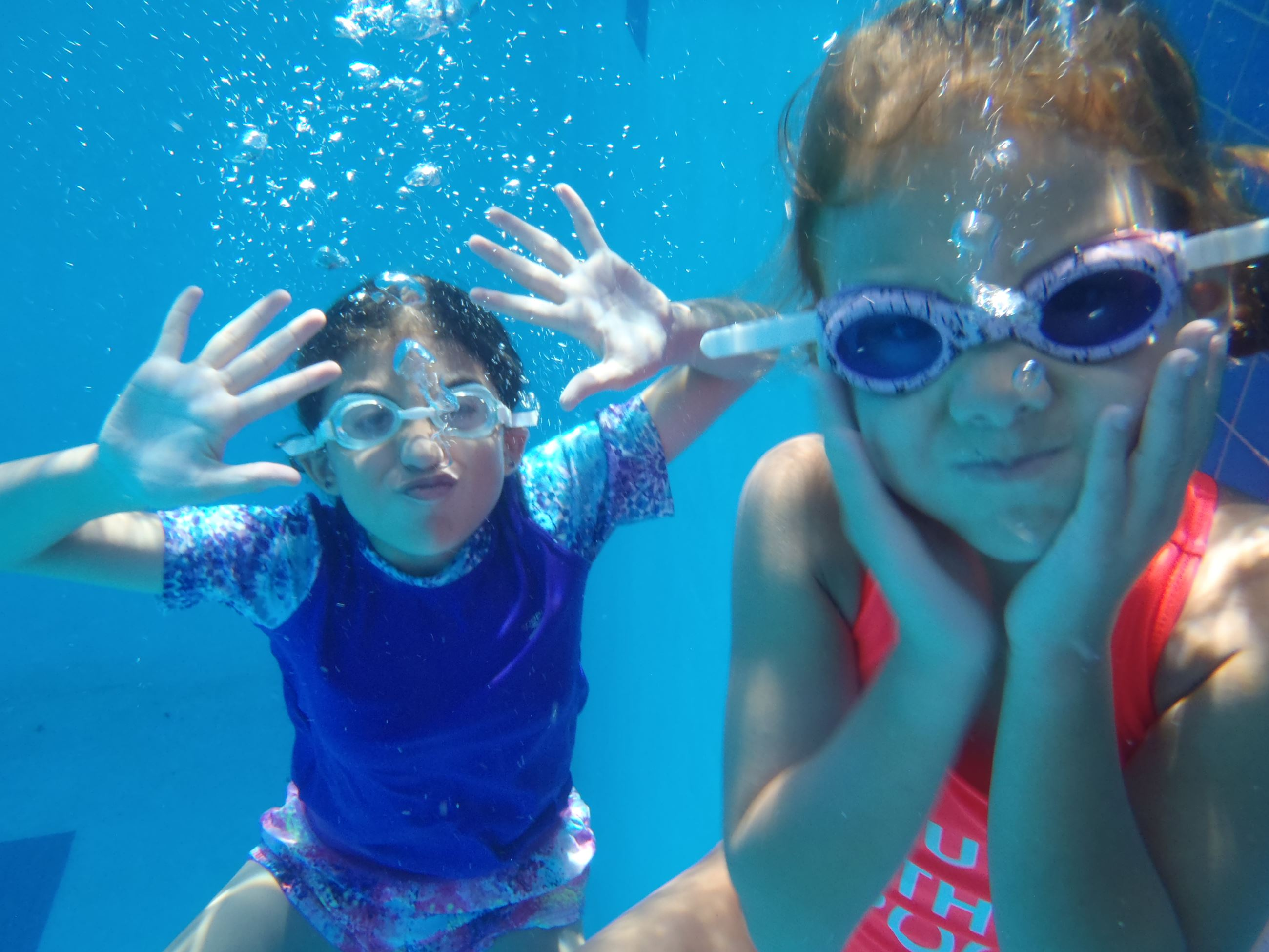 Two girls underwater