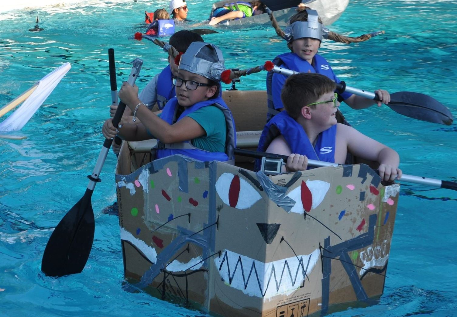 kids in cardboard boat